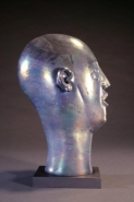 Head As Egg Chocolate Iridescent Lava Bust Side View by Richard Jolley